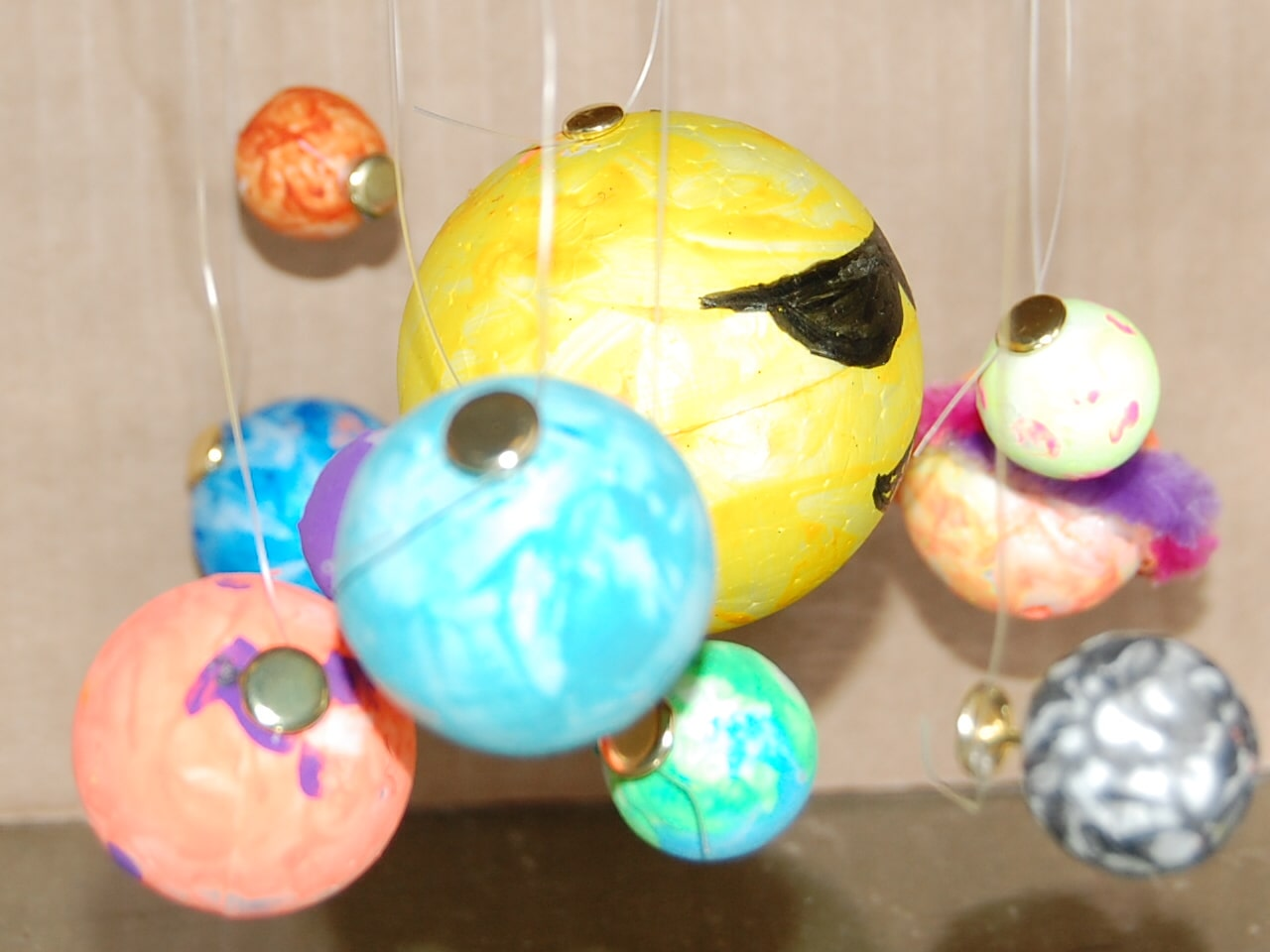 Diorama of painted planets.
