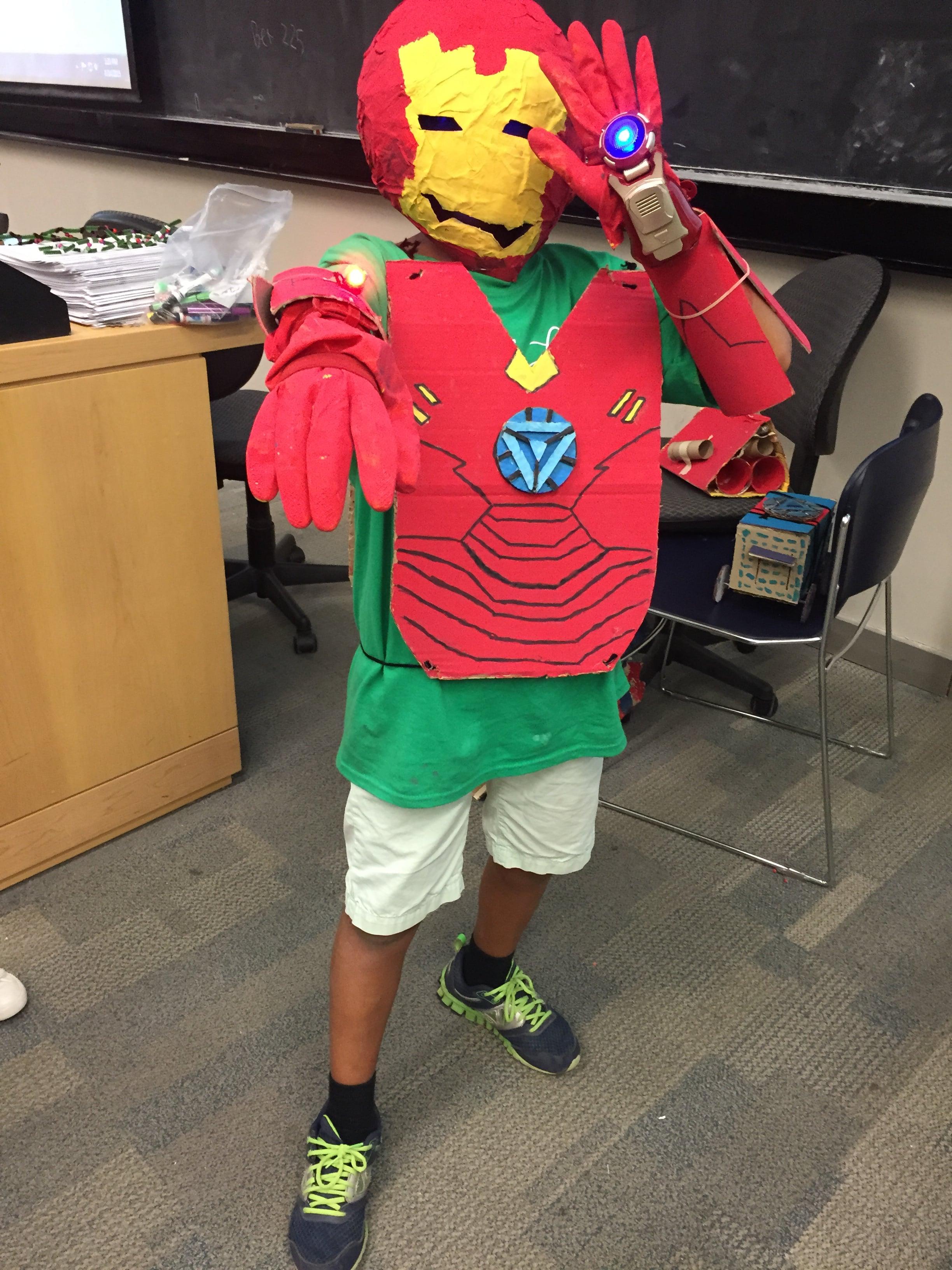 Young boy wearing makeshift Iron Man costume.
