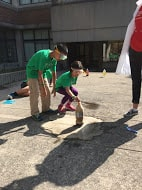 Two young students doing outdoors experiment.