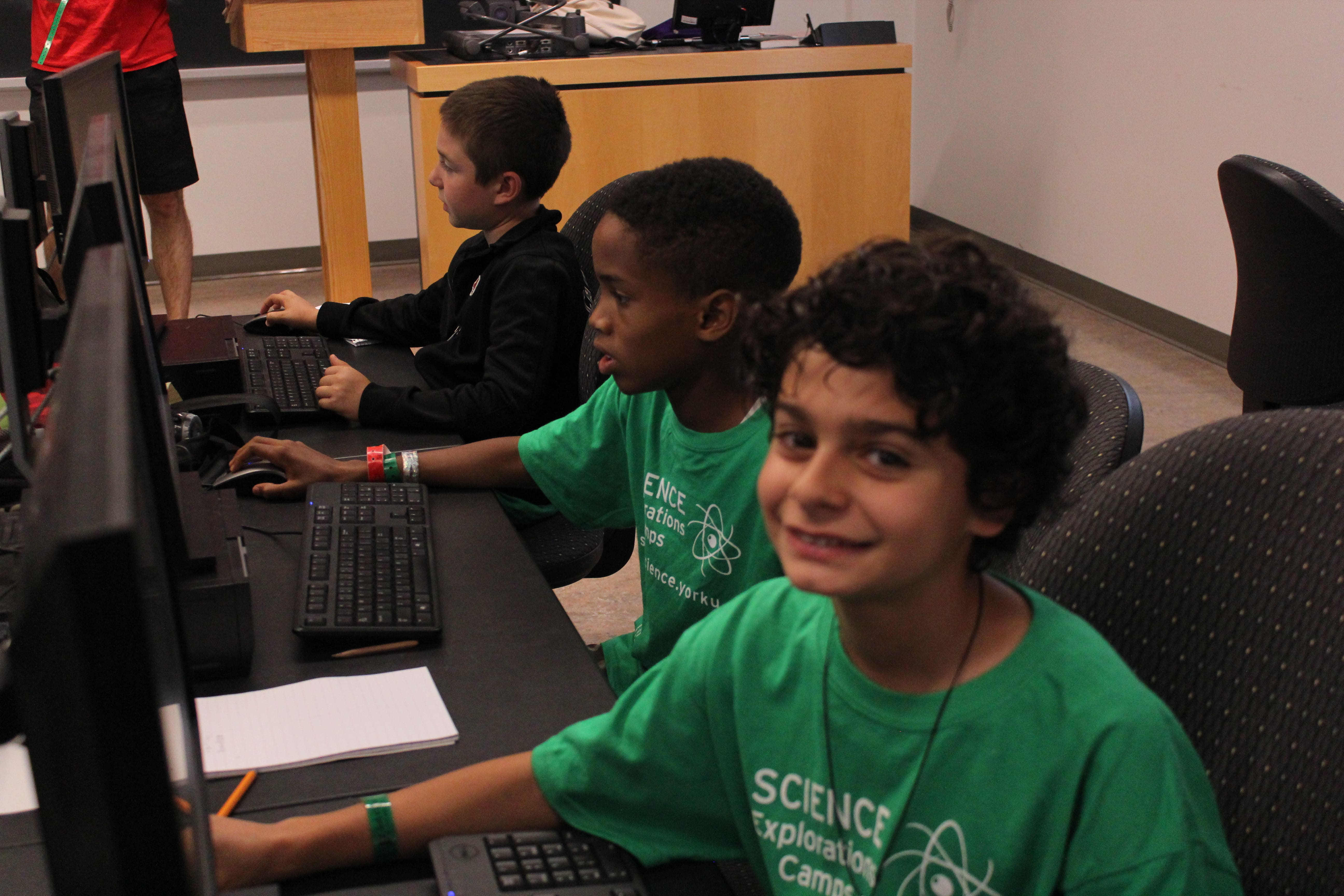 Young boys on computers in classroom.