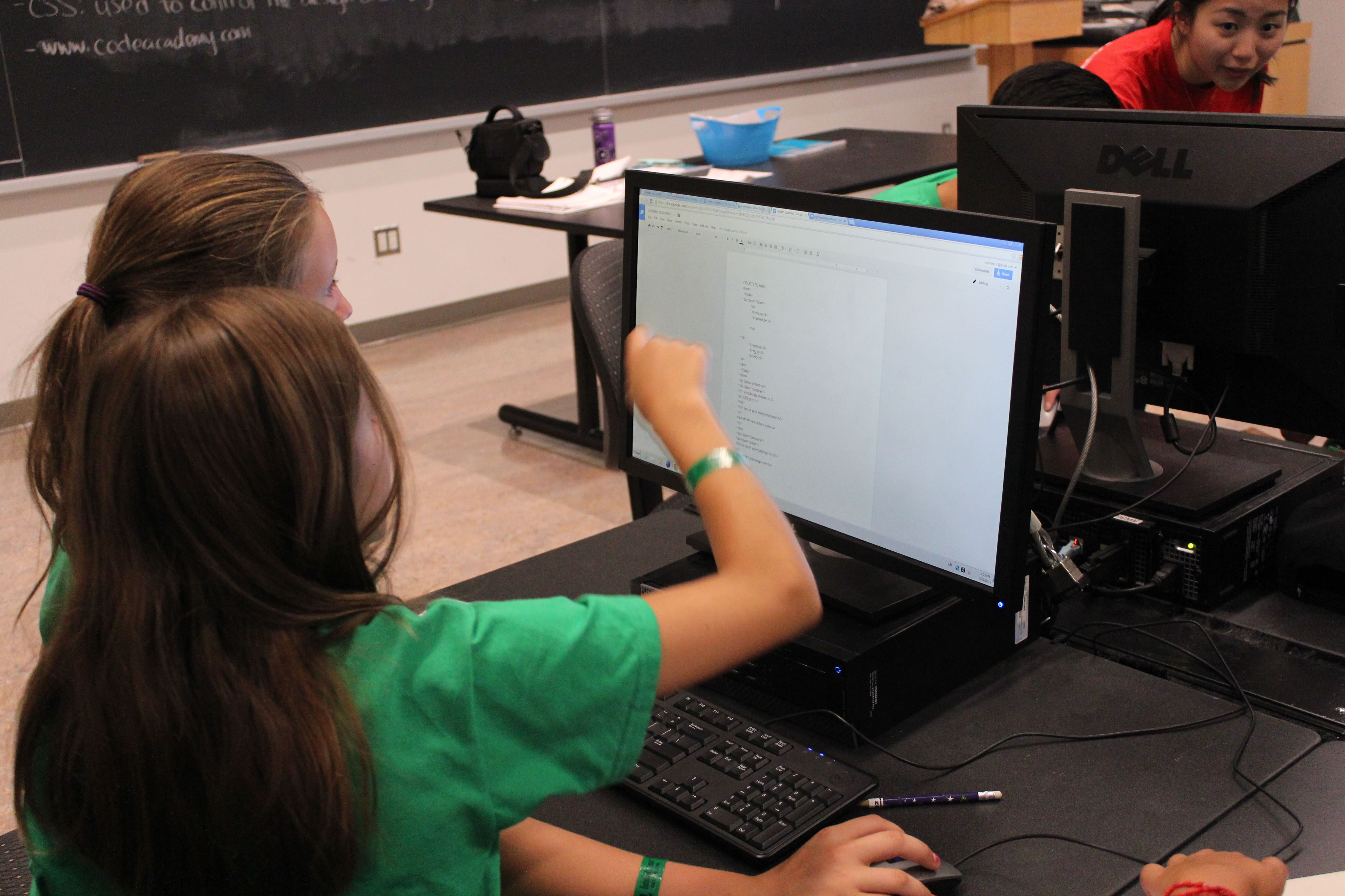 Young girls on computer in classroom.